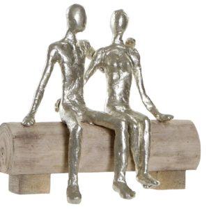 Figura aluminio pareja sobre madera